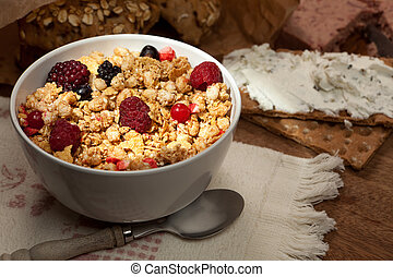 Crunchy cereals bowl - Dark breakfast table with bowl of...