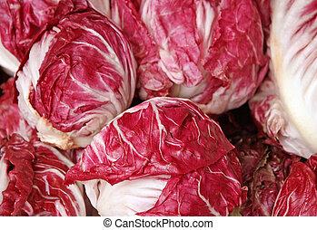 crunchy radicchio heads for sale at vegetable market -...