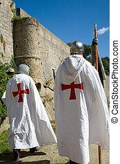Crusaders walking along the castle