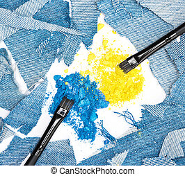Crushed compact blue and yellow eyeshadow with rags of denim...
