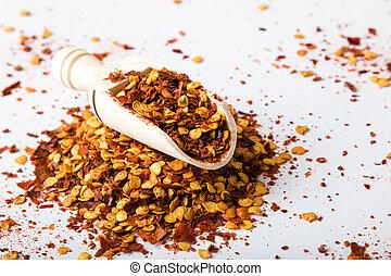 chili flakes on white table