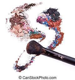 crushed eyeshadows mixed with brush isolated on white...