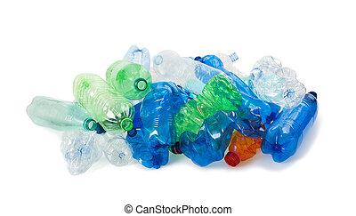 plastic bottles - crushed plastic bottles on a white ...