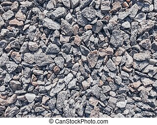 Crushed stone lying on the ground texture