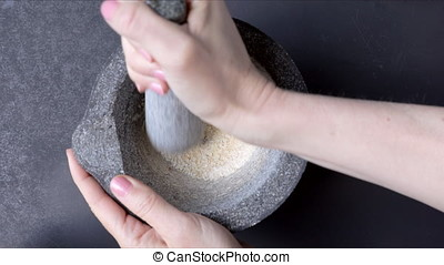 Crushing Dried Onion - Grinding dried onions in a stone...