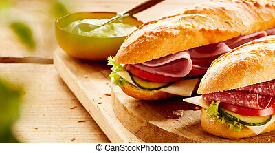 Crusty baguettes with cold ham and salami filling