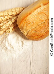 Crusty fresh roll with wheat and flour