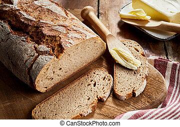 Crusty loaf of freshly baked rye bread