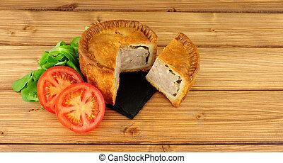 Crusty Savoury Pork Pie - Crusty savoury pork pie on a wood...
