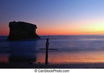 cruz, en la playa