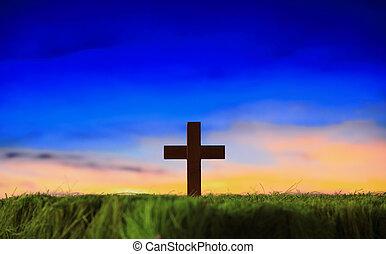 cruz, silueta, en, pasto o césped, con, ocaso, plano de fondo