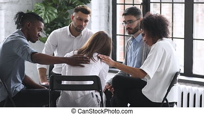 Upset crying addict woman share problem at group therapy suffer from abuse grief get psychological support of counselor diverse people friends help patient at psychotherapy counseling session concept