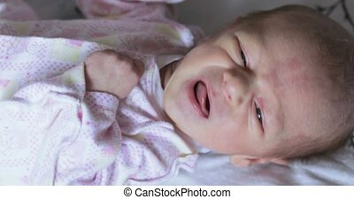 Crying baby boy at home - Lying on the bed baby boy cries