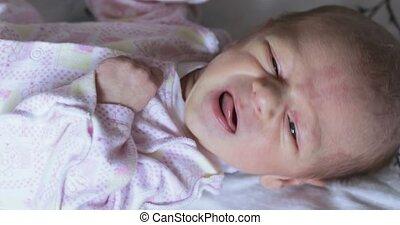 Crying baby boy at home