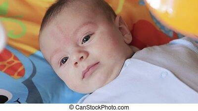 Crying baby boy at rocking cradle