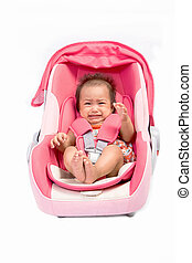 crying baby in car seat, isolated on white