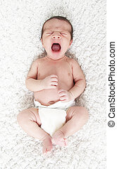 crying baby - Crying newborn on a blanket.