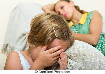 Crying child and mother at home