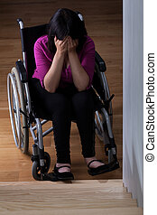 Crying disabled woman