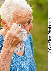 Crying elderly woman