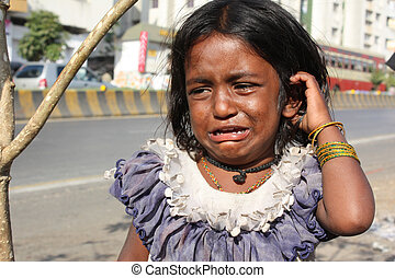 Crying for Food - A little beggar girl from India standing...