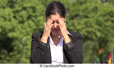 Crying Hispanic Business Woman