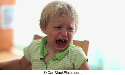 Crying little baby girl