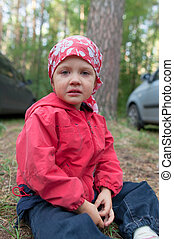 Crying little girl in forest
