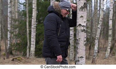 Crying man near birch