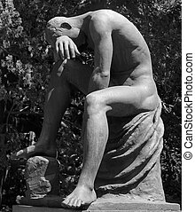 crying man statue  as tombstone on monumental cemetery of Staglieno