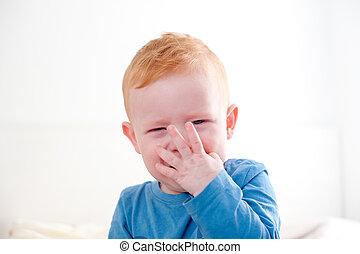 Crying redhead baby