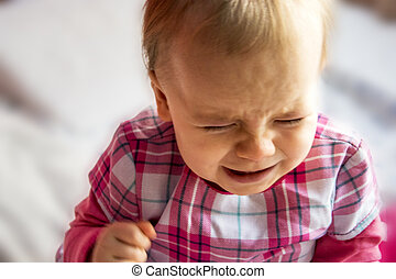 crying unhappy little child. little girl is flooding with tears