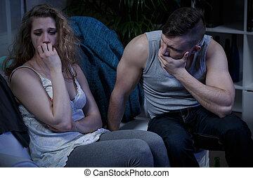 Crying woman and terrified husband