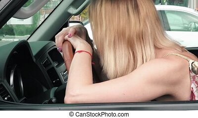 Crying woman in a car. Emotional stress