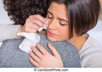 Crying woman is hugging her sister. - Feeling sad. Young...
