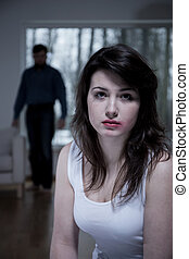 Crying woman living with aggressive husband - Portrait of...