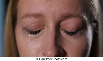 Crying woman with mascara running down her face