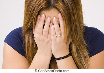 crying woman - young depressed woman crying on white...