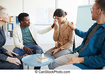 Crying Young Woman in Support Group