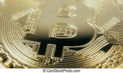 Crypto currency Gold Bitcoin - BTC - Bit Coin. Macro shots crypto currency Bitcoin coins rotating. Seamless looping.