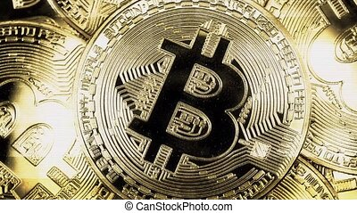 Crypto currency Gold Bitcoin - BTC - Bit Coin. Macro shots crypto currency Bitcoin coins rotating. Holomatrix style. Seamless looping.