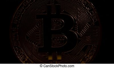 Crypto currency Gold Bitcoin - BTC - Bit Coin. Rotating on black.