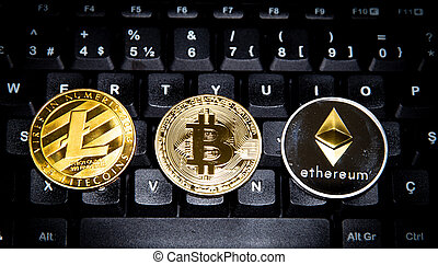 Cryptocurrency Bitcoin, Litecoin and Ethereum on a Keyboard...