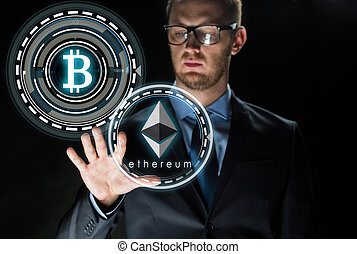 businessman with ethereum and bitcoin holograms - ...
