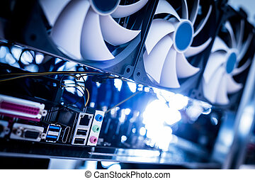 Cryptocurrency mining machine in a close-up shot. IT ...