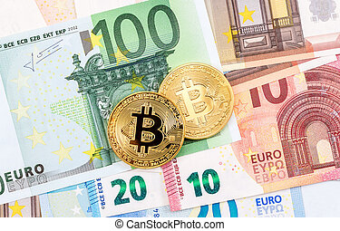 Cryptocurrency of the Bitcoin lying on the euro banknotes. ...