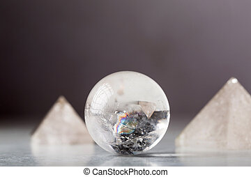 crystal ball and rock crystal pyramids