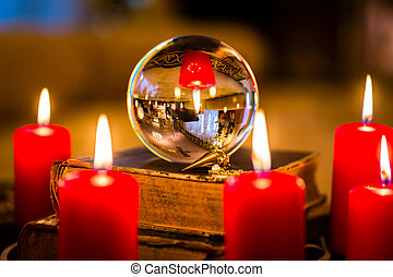 Crystal ball in the candle light to prophesy - Crystal ball...