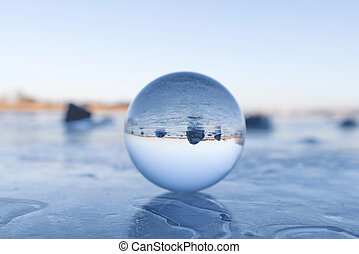 Crystal ball on a frozen lake in the winter