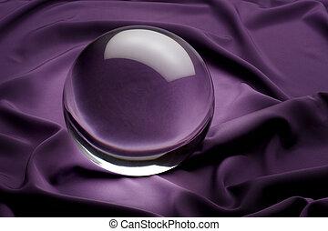 glowing crystal ball shot on purple satin